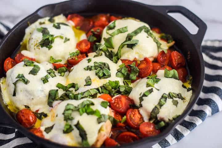 chicken caprese in a cast iron skillet