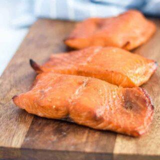 Ninja Foodi salmon on a wooden cutting board