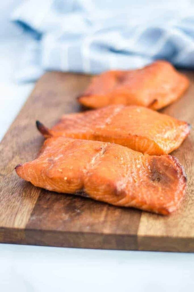 Ninja Foodi salmon on a wooden cutting board