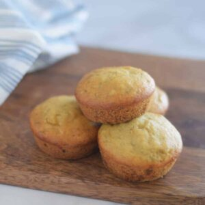olive oil and honey banana muffins on a wooden board