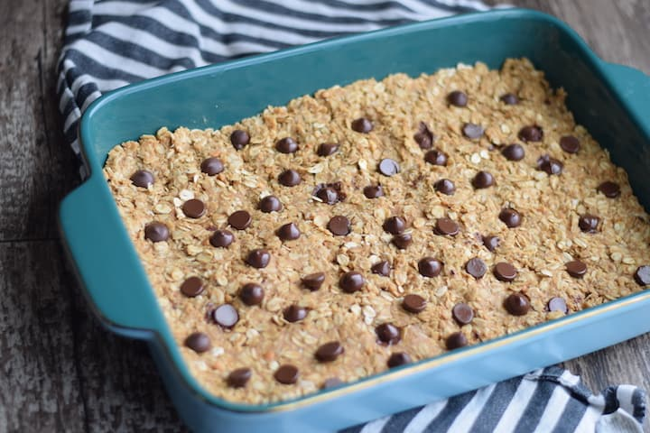 granola bars in a blue baking dish prior to cutting