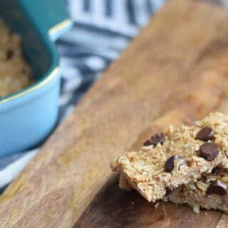 homemade peanut butter granola bars on a wooden cutting board