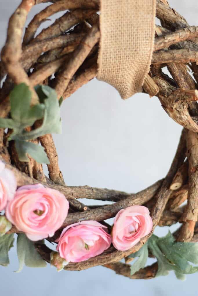diy spring wreath hanging with burlap ribbon
