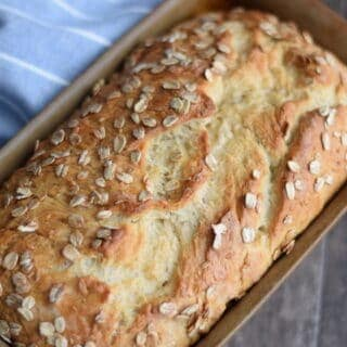 honey oat bread in a bread pan
