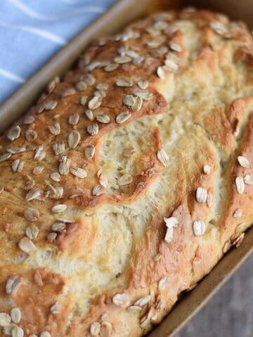 honey oat bread in a bread pan