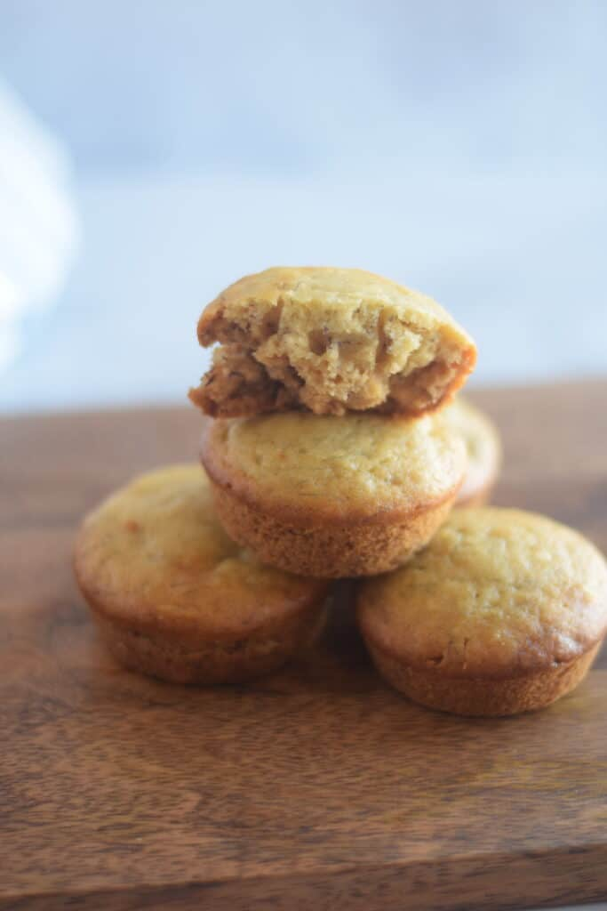 stack of honey banana muffins on a wooden board
