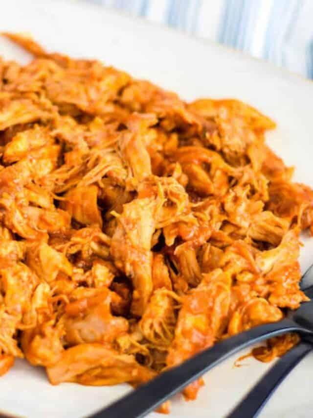 white platter of fresh homemade shredded bbq chicken