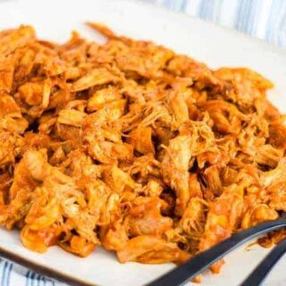white platter of fresh homemade shredded bbq chicken