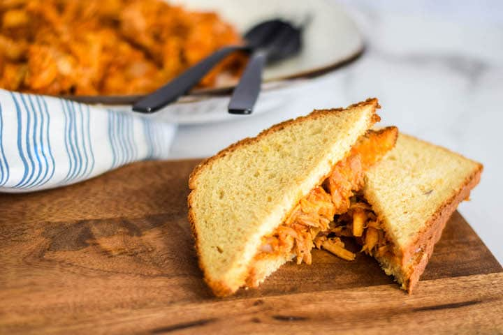 shredded bbq chicken over grainy bread  and cut in half