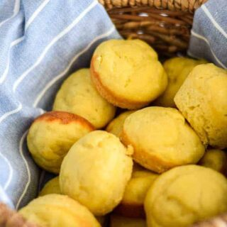 dinner rolls in a wicker basket