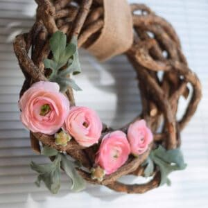 close up image of the ranunculus flowers in the wreath