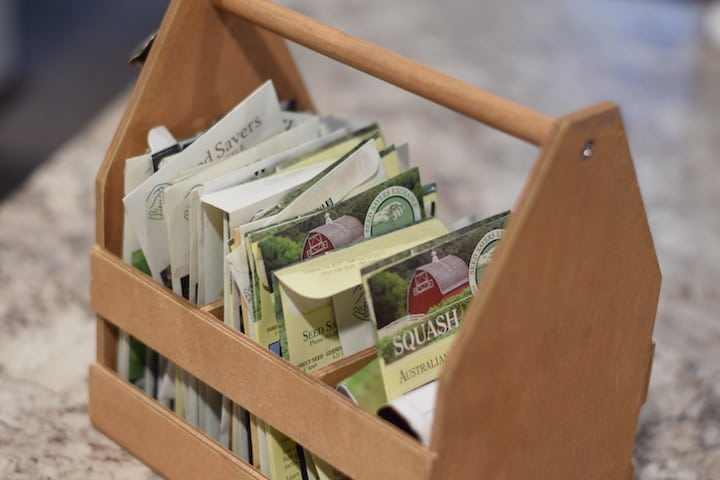 seed packets in wooden box with handle