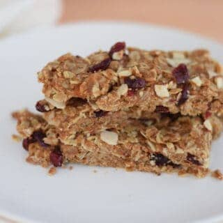 stack of granola bars on white plate