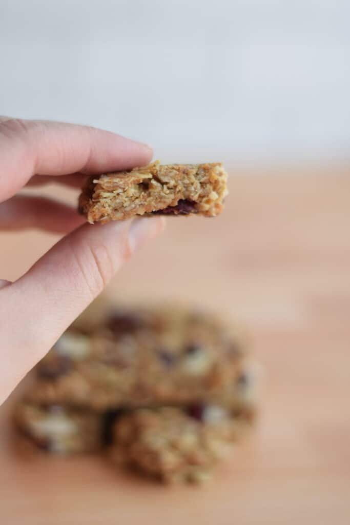 cranberry almond granola bar close up in hand