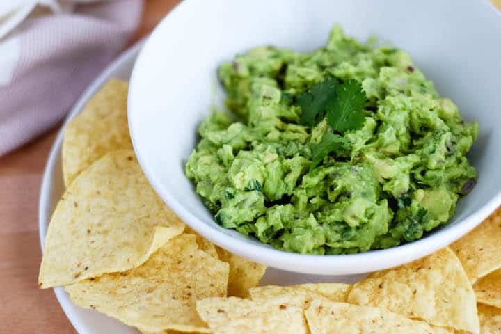 closeup image of a bowl of fresh guacamole dip