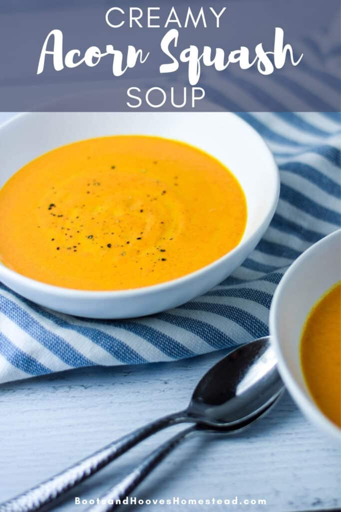 blue header text overlay that reads creamy acorn squash soup with the image of the soup in a white bowl in the background
