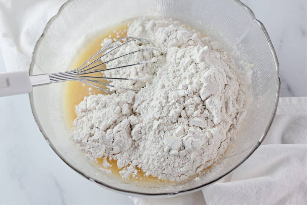 combining the flour with the wet ingredients