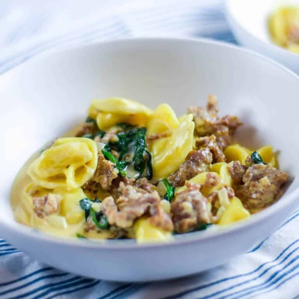 white pasta bowl with creamy tortellini recipe