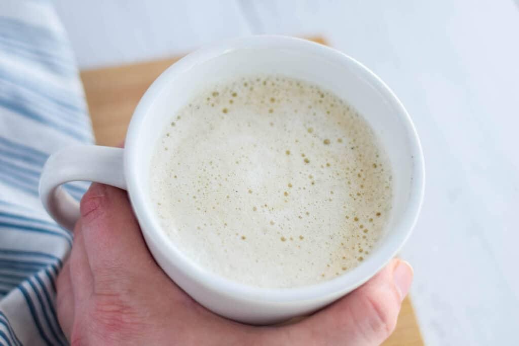 white chocolate latte in a white coffee mug