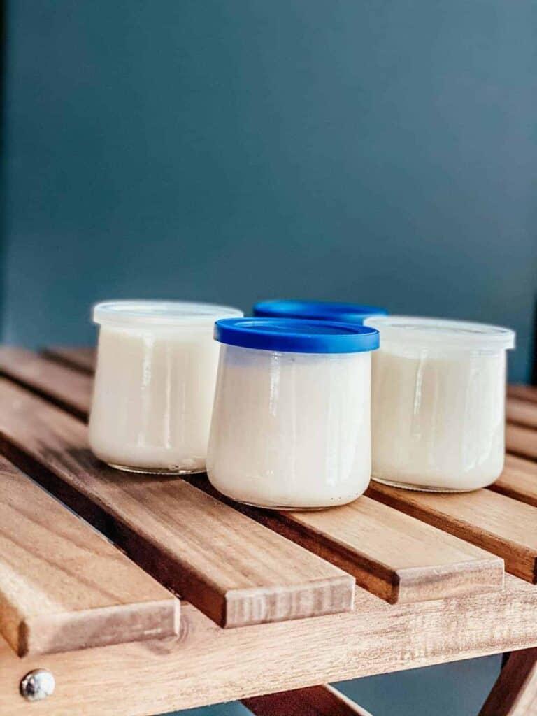 homemade Ninja Foodi yogurt in small glass jars with lids