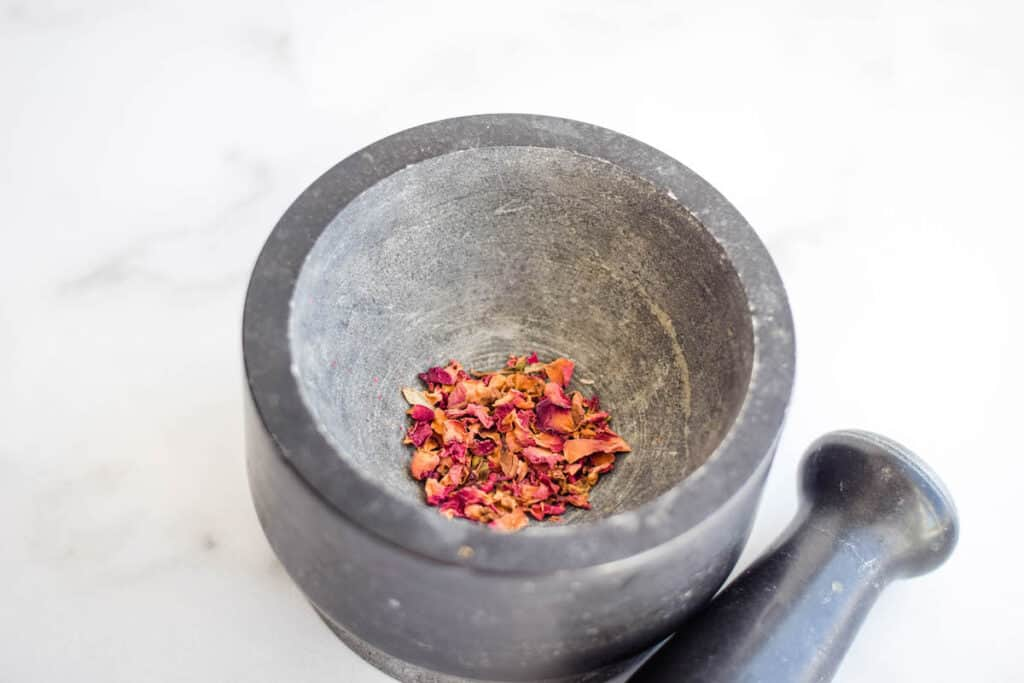 dried rose petal in a motar & pestle