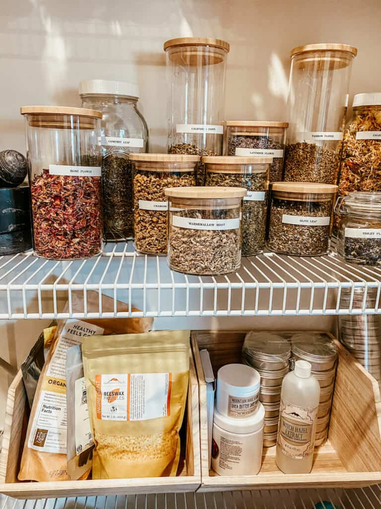 dried herbs in storage jars with labels