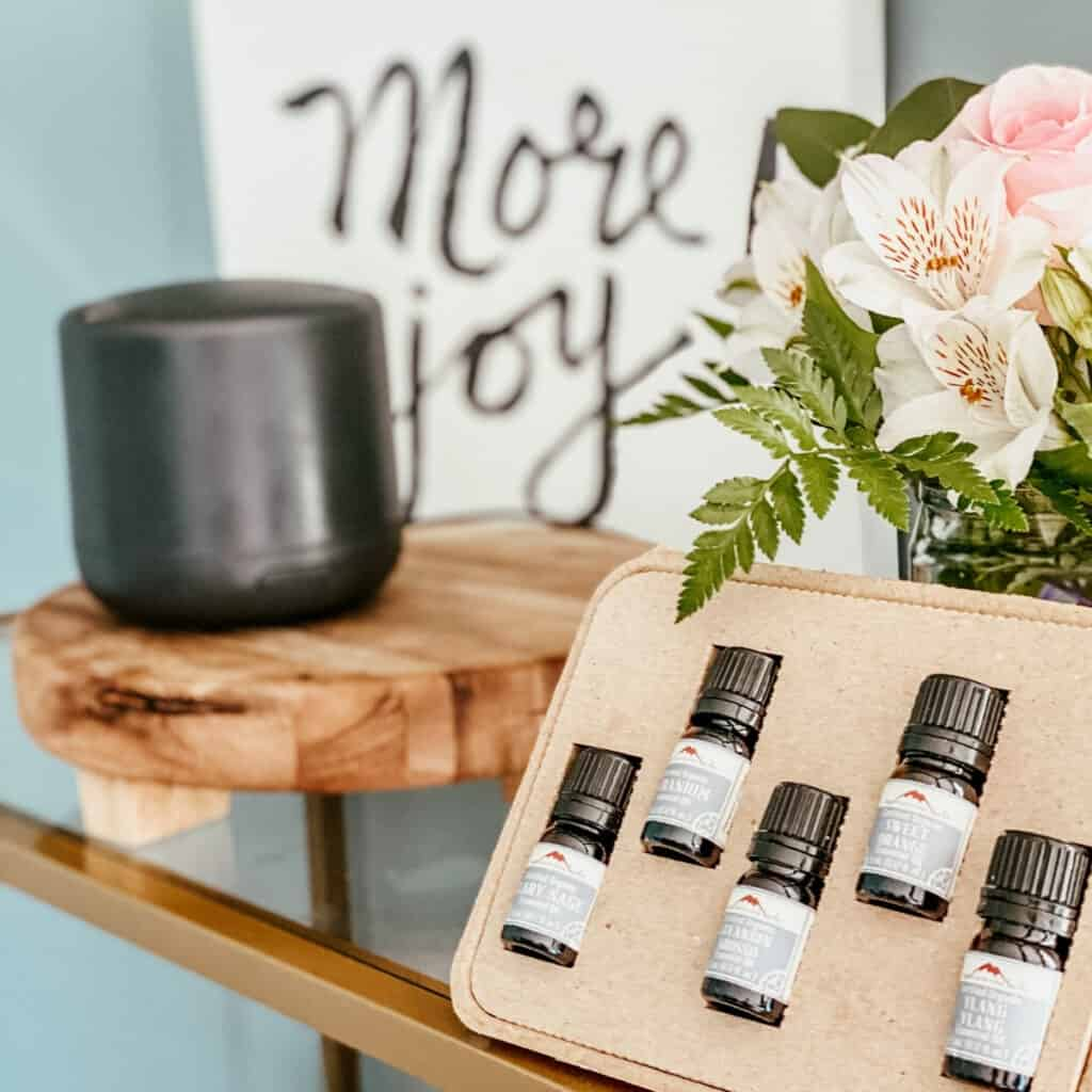 essential oil kit with flowers in background