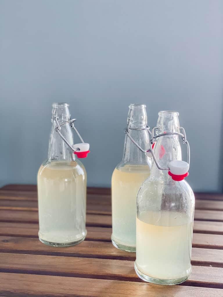 3 flip top bottles with flavored water kefir