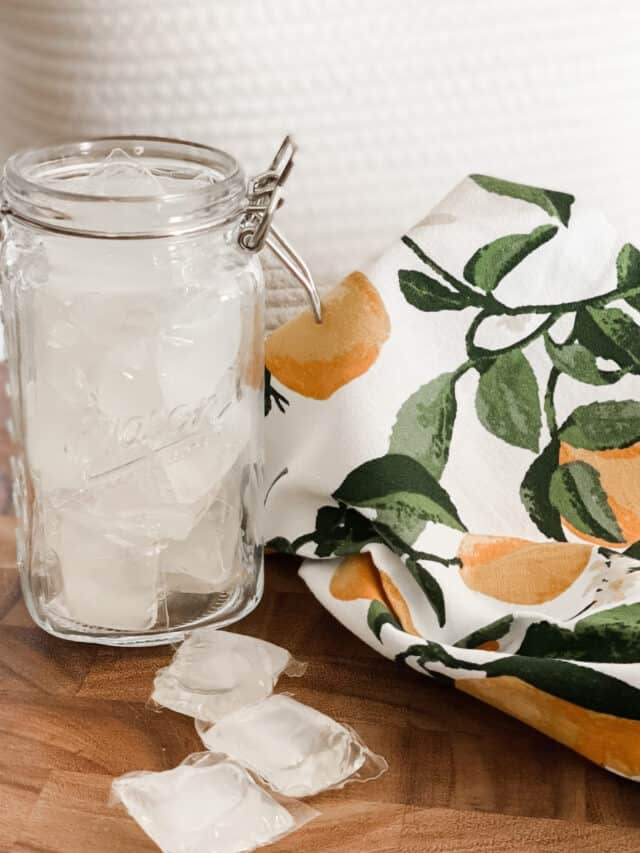 flip top mason jar filled with natural laundry detergent pods
