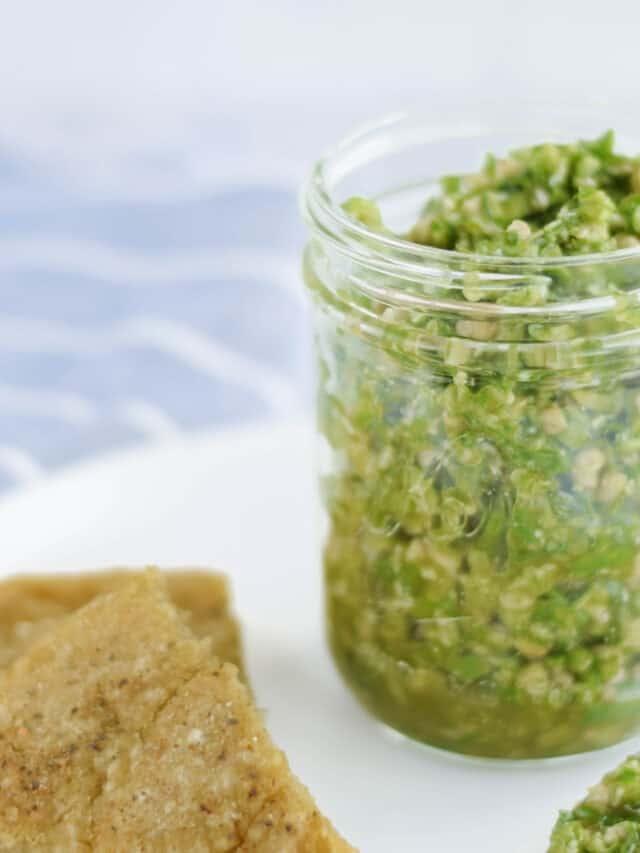 closeup of garlic pesto in a glass jar