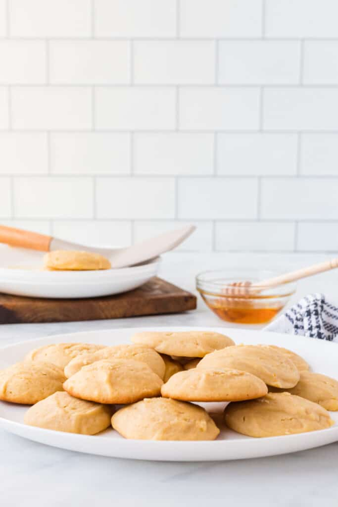white plate filled with honey butter cookies