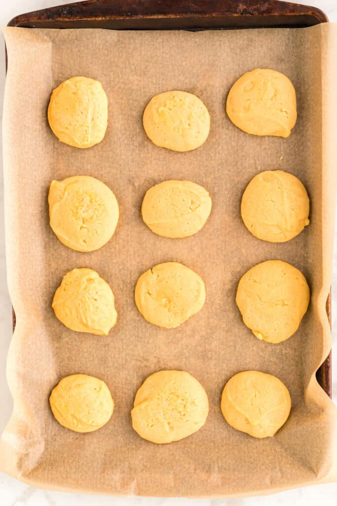 cookies on a baking sheet and parchment paper out of the oven
